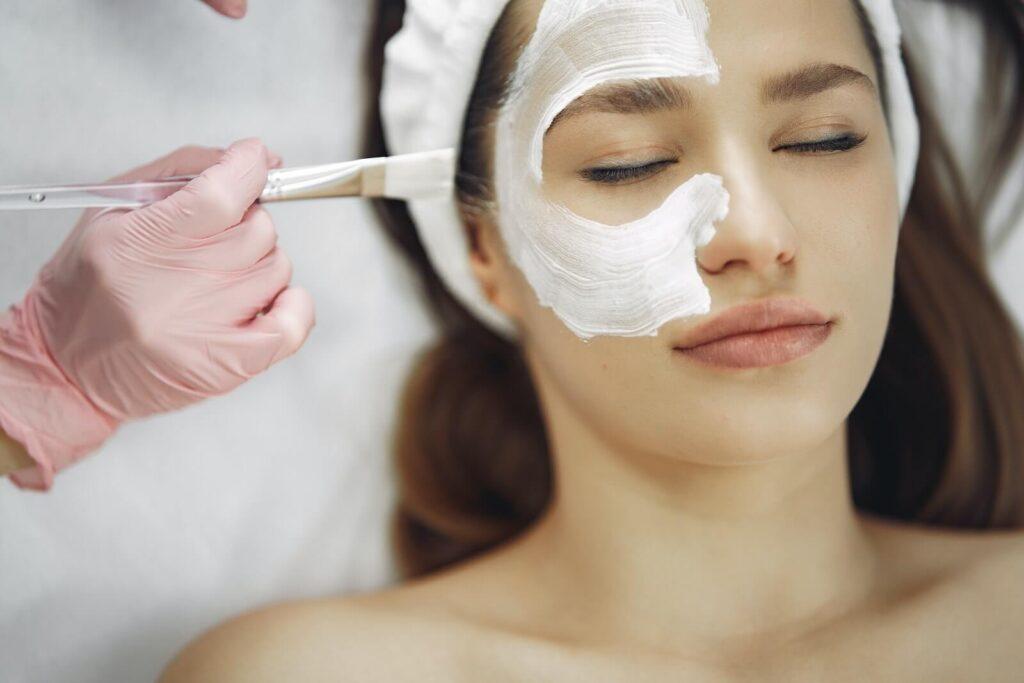 Woman gets relaxing facial at spa company