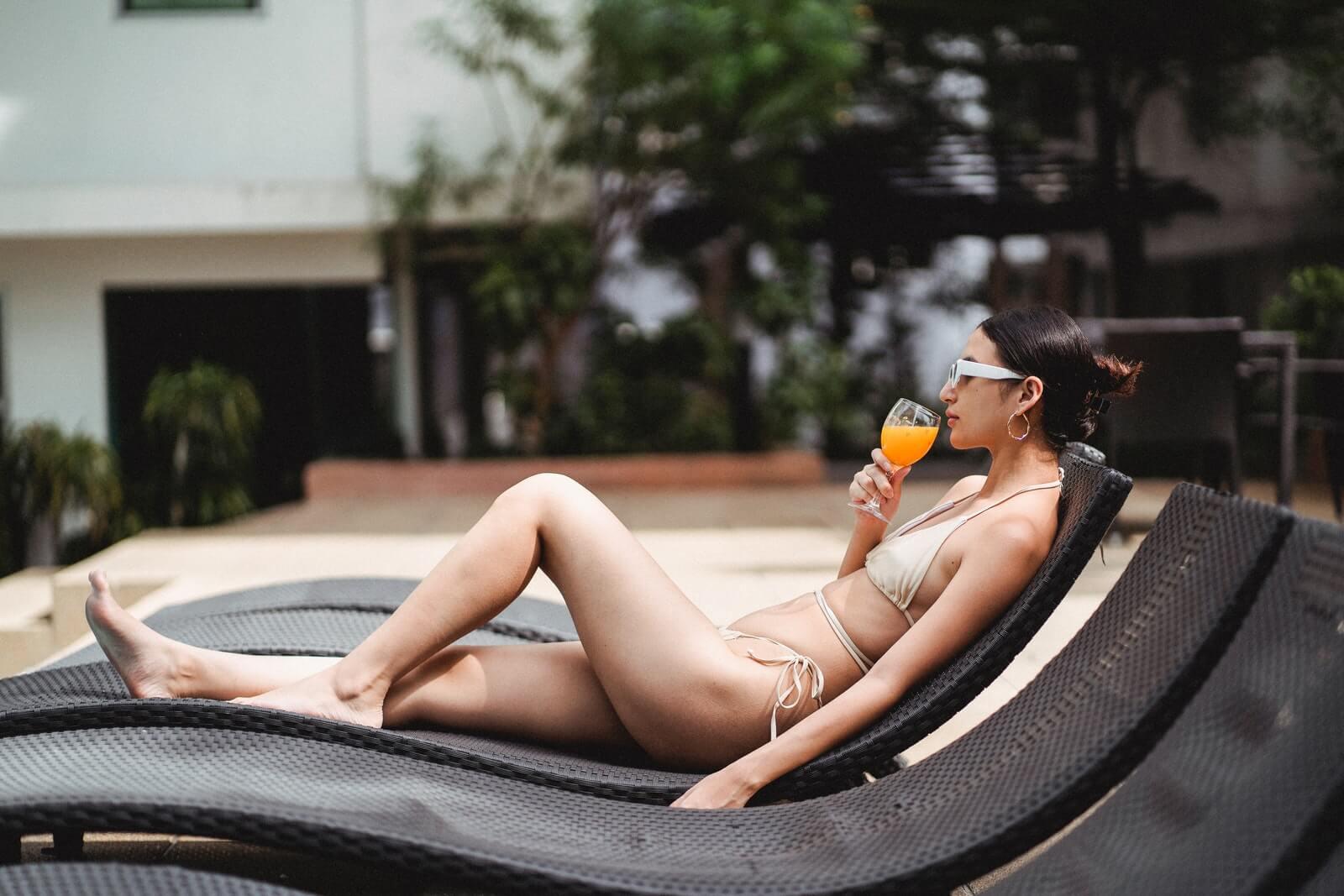 woman in bikini enjoys poolside